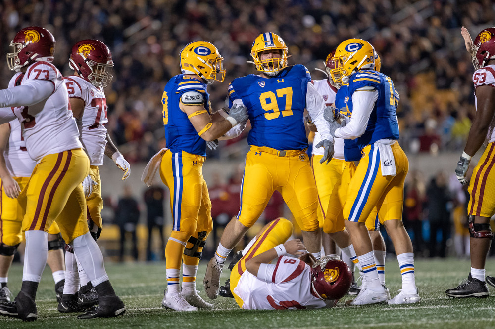 November 16, 2019; Memorial Stadium, Berkeley, California, USA; Football: California Golden Bears vs. USC Trojans. Aaron Maldonado (97), Ben Hawk Schrider (98), Cameron Goode (19); Photo credit: Al Sermeno - KLC fotos